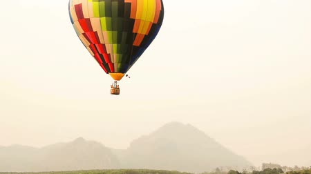 on air : Balloons float across the sky at the Chiang Rai Balloon Festival in Thailand