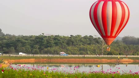 rai : Balloons float across the sky at the Chiang Rai Balloon Festival in Thailand