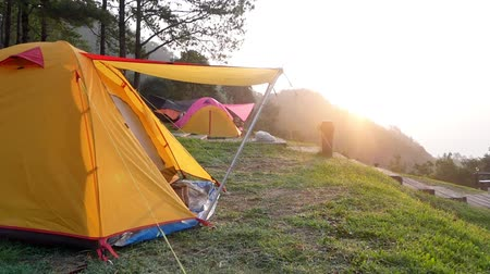 Camping orange tent at Doi Ang Khang National Park in Chiang Mai,Thailand is blessed with a lush green mountains range and various natural attractions such. 影像素材