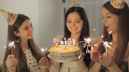 desejando : Three pretty girls celebrate and applaud. Birthday girl blows out the candles on the cake Full HD 1080 NTSC