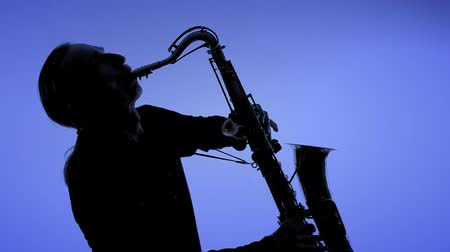 джаз : Man playing sax in silhouette.  NTSC. You can change the background color using the tool HSL