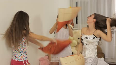 kavga : Three young women having fun (pillow fight)