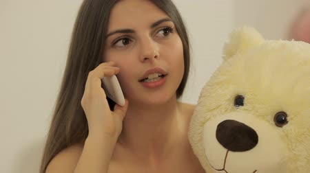 angrily : Wicked girl talking on the phone Stock Footage