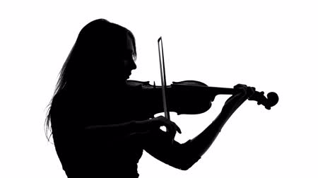houslista : Black silhouette of girl in a dress playing the violin
