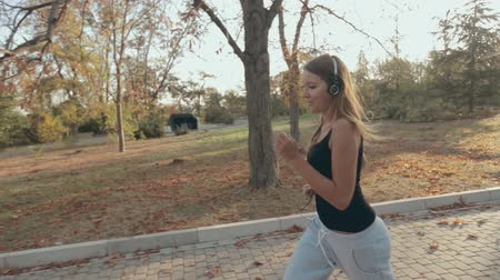 jogging : Lovely girl jogging through the park