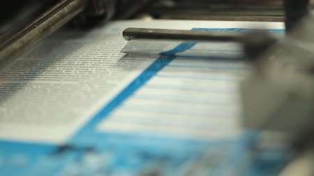 print shop : Close-up of  printing flyers in print shop Stock Footage