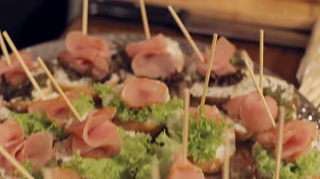общественное питание : Canape with lettuce and smoked meat in a catering