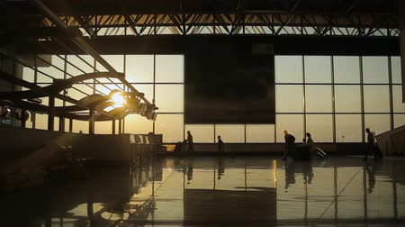 milan : Silhouettes of travelers at the airport