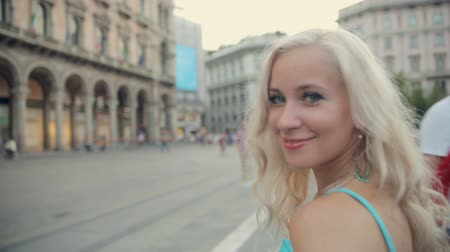 milan : Amazing blonde walking down the street of Milan Stock Footage