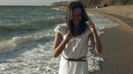 ремень : Beautiful girl on the seashore in summer