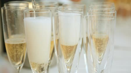setting : Waiter pours champagne into glasses