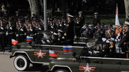 komutan : SEVASTOPOL,CRIMEARUSSIA-MAY 7,2015: The commander drive in the car in front of the formation of military and welcomes them on rehearsal of parade dedicated in honor of the seventieth anniversary of the Great Victory on May 7, 2015 in Sevastopol, Russia. Stok Video