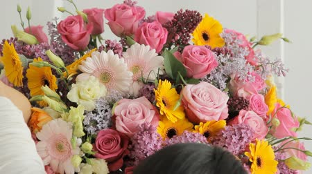 communion : Florists make a fashion bouquet from a huge variety of colorful flowers