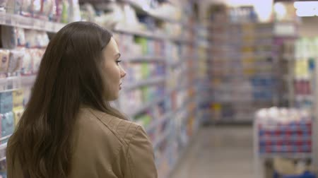 bakkal : Sweet young woman walking on the supermarket