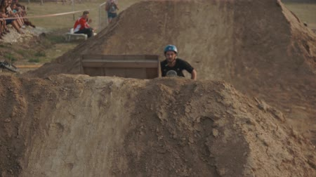 gimmick : Slow motion series of extreme stunts by bmx rider  on the bike. Dirt jumping competition.