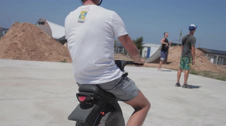 personal transporter : Guy in a helmet riding a unicycle bike. Segway