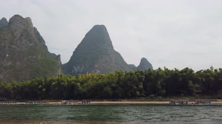 guangxi : Li river and karst formation landscape in Xinping between Guiling and Yangshuo, Guangxi province, China Stock Footage