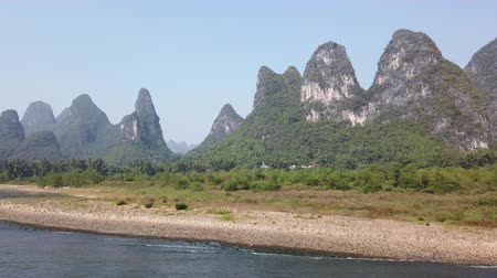 guangxi : Boat on Li river cruise and karst formation landscape in the fog between Guiling and Yangshuo, Guangxi province, China