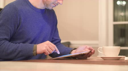 mysz : Different views of a man using electronic devices in a home.