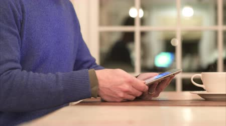akıllı telefon : Different views of a man using electronic devices in a home.