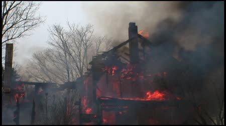 first officer : A home is completely destroyed by fire. Stock Footage
