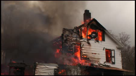 fire officer : A home is completely destroyed by fire. Stock Footage