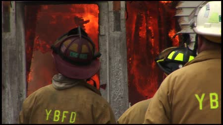 firemen : A home is completely destroyed by fire. Stock Footage