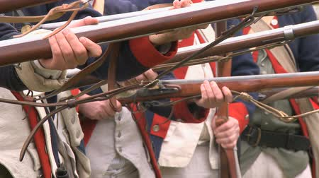 war : Soldiers line up during a revolutionary war battle reenactment
