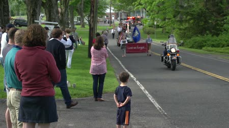 kasaba : Residents watch a parade in a quaint New England town.