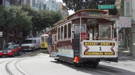 подсвечник : A scene of Trolley Cars taking passengers around the city of San Francisco