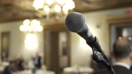 tiyatro : A microphone is ready on stage it a business event