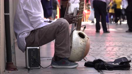 homeless : View of street musician playing the kora harp-lute in Bilbao, Spain