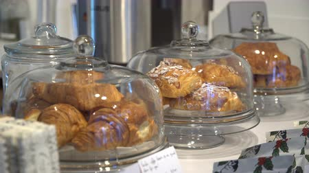 pastelaria : A view of croissants on display in a coffee shop Stock Footage