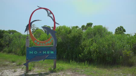 istiridye : A pan of the Ho Hum beach sign on Fire Island on a gorgeous sunny day