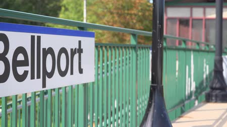 caboose : A view of the Bellport, NY train platform in summer Stock Footage