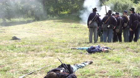 aggression : View of Dead and wounded on battlefield of civil war