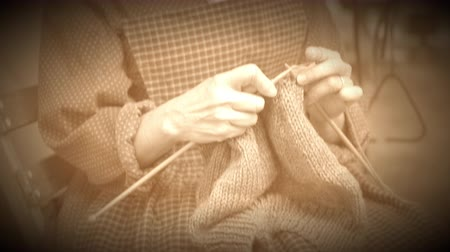 fülke : View of a woman knitting in a civil war camp (Archive Footage Version) Stock mozgókép