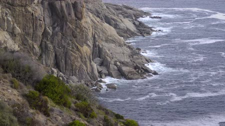 Scene of waves crash against the rocks near Hout Bay