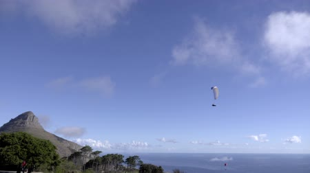 Scene of para glider soars near Lions Head mountain Stock Footage