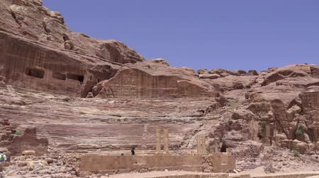 Left pan of theater carved into rock of Petra