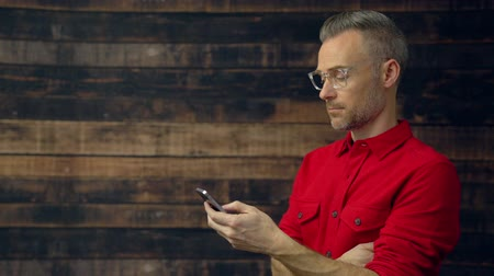 View of stylish man using handheld device Stock Footage