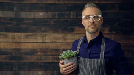 kept : Scene as hipster business owner smiles at camera
