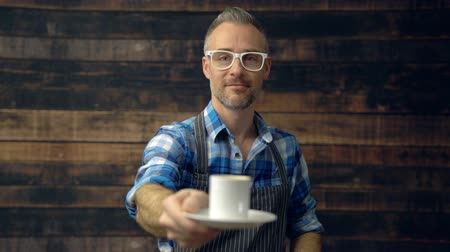 View of hipster barista holding out an espresso Stock Footage