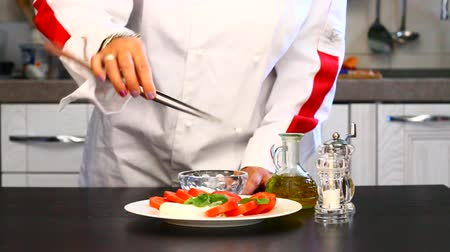 preparing dish with mozzarella and tomatoes Stock Footage