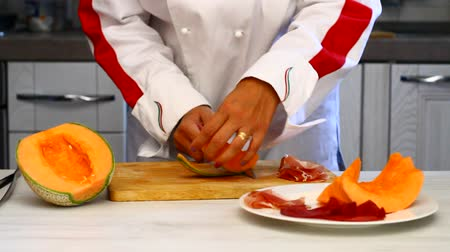 chef preparing dish with melon and ham Stock Footage