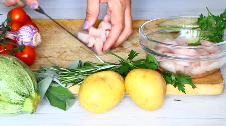 Chef prepares chicken nuggets with rosemary and sage