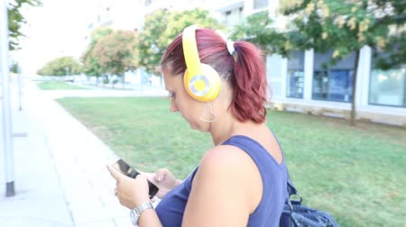 smiling woman walking listen music with headphone Stock Footage