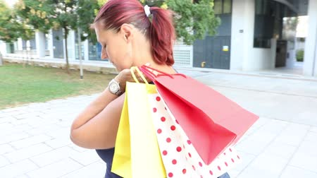 smiling woman walking with shopping bag Stock Footage
