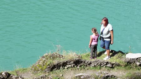 mom and daughter during an excursion to the lake greet