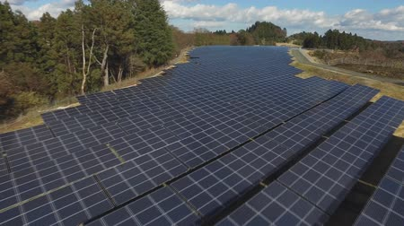 kolektor : Solar panels in wooded area (Drone footage)